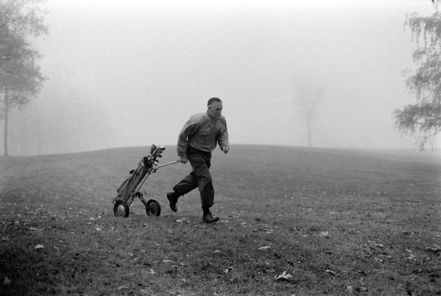 Michigan governor George Romney on the golf course, 1963.