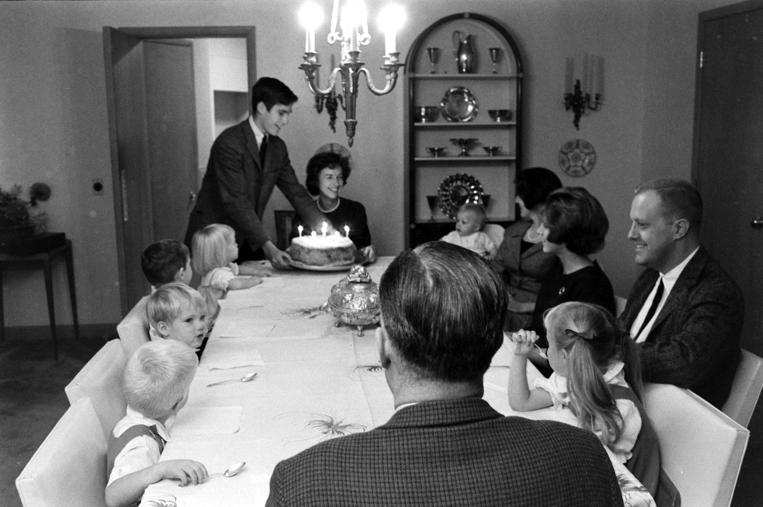 Mitt Romney places a birthday cake before his mother, Lenore, in November 1963.