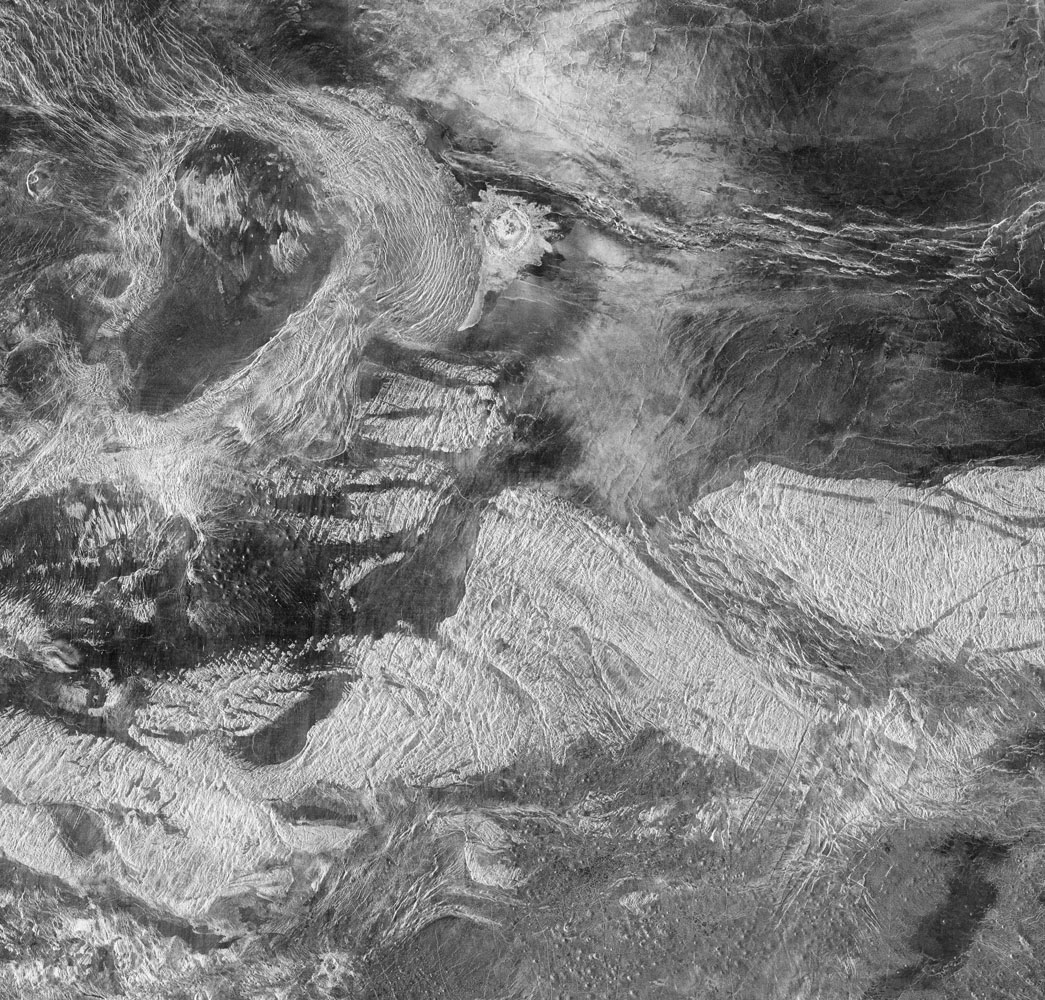 The oval-shaped feature in the upper left, Tusholi Corona, overlaps La Fayette impact crater in the Tethus Regio (region) of Venus.                               Radar image, Magellan, Sept. 15, 1990 – Sept. 14, 1992