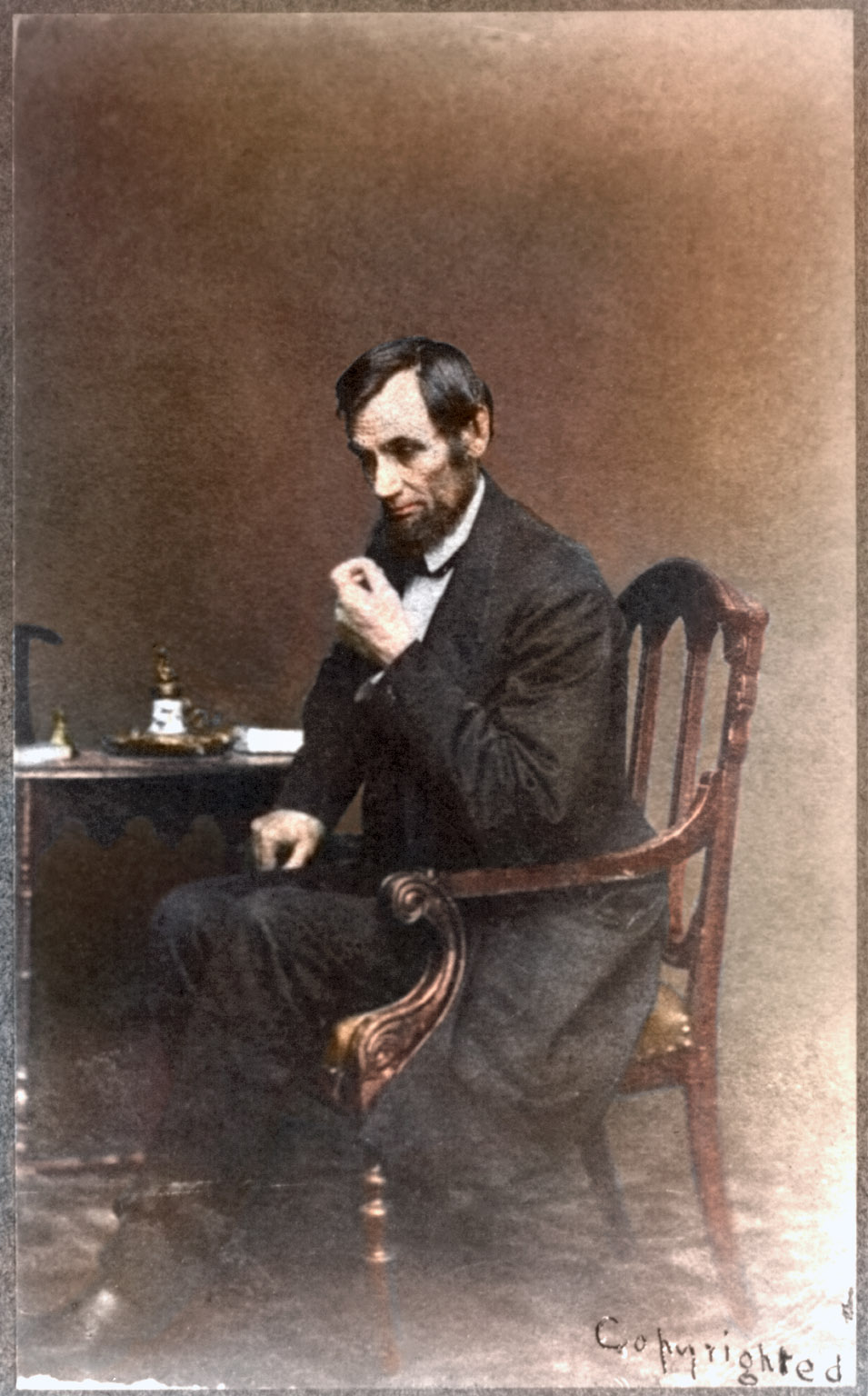 May 16, 1861. Abraham Lincoln, seated next to small table in Mathew Brady's studio in Washington, D.C.