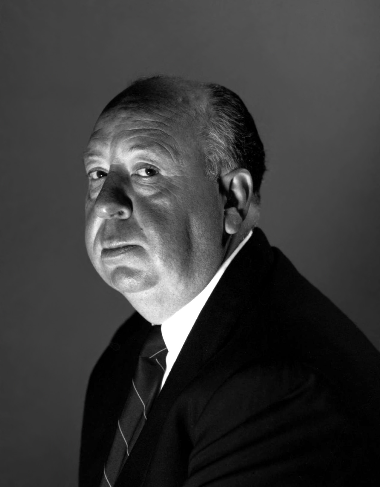 Circa 1955. British film director Alfred Hitchcock.
