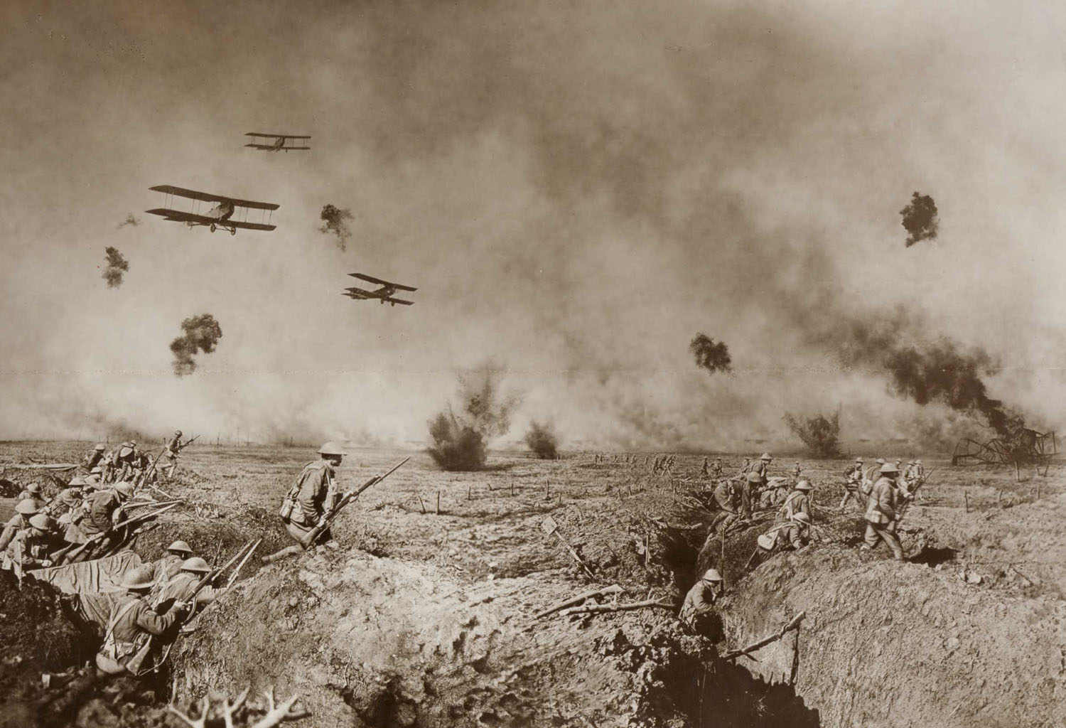 An episode after the Battle of Zonnebeke. Australian Infantry moving forward to resist a counter attack. On the extreme right a machine brought down in flames is burning fiercely. Our advance is supported by bombing planes, whilst the enemy is supporting his attack with a heavy barrage.                                  c. 1918                  James Frank Hurley, Australian, 1885–1962