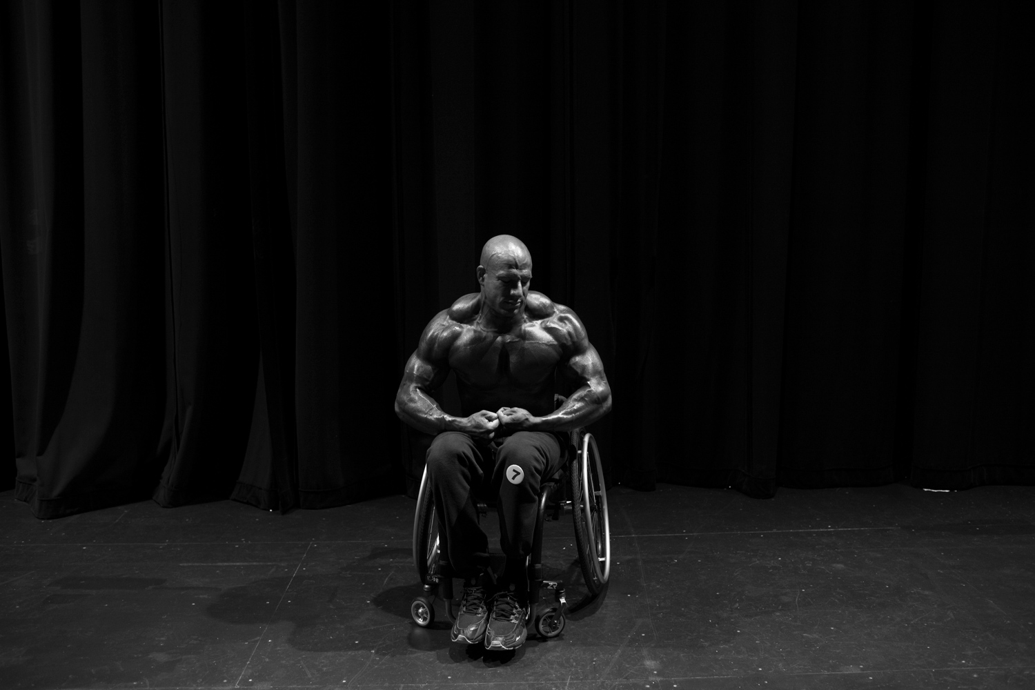 Nick Scott practices his poses backstage at the first ever Wheelchair Pro Show in Houston.