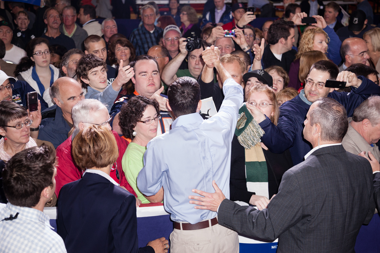 """Paul Ryan shakes hands in the crowd at the  Earn It  rally in Derry, N.H. Sept. 29, 2012. The event was part of the campaign's """"Earn It"""" day of volunteering."""