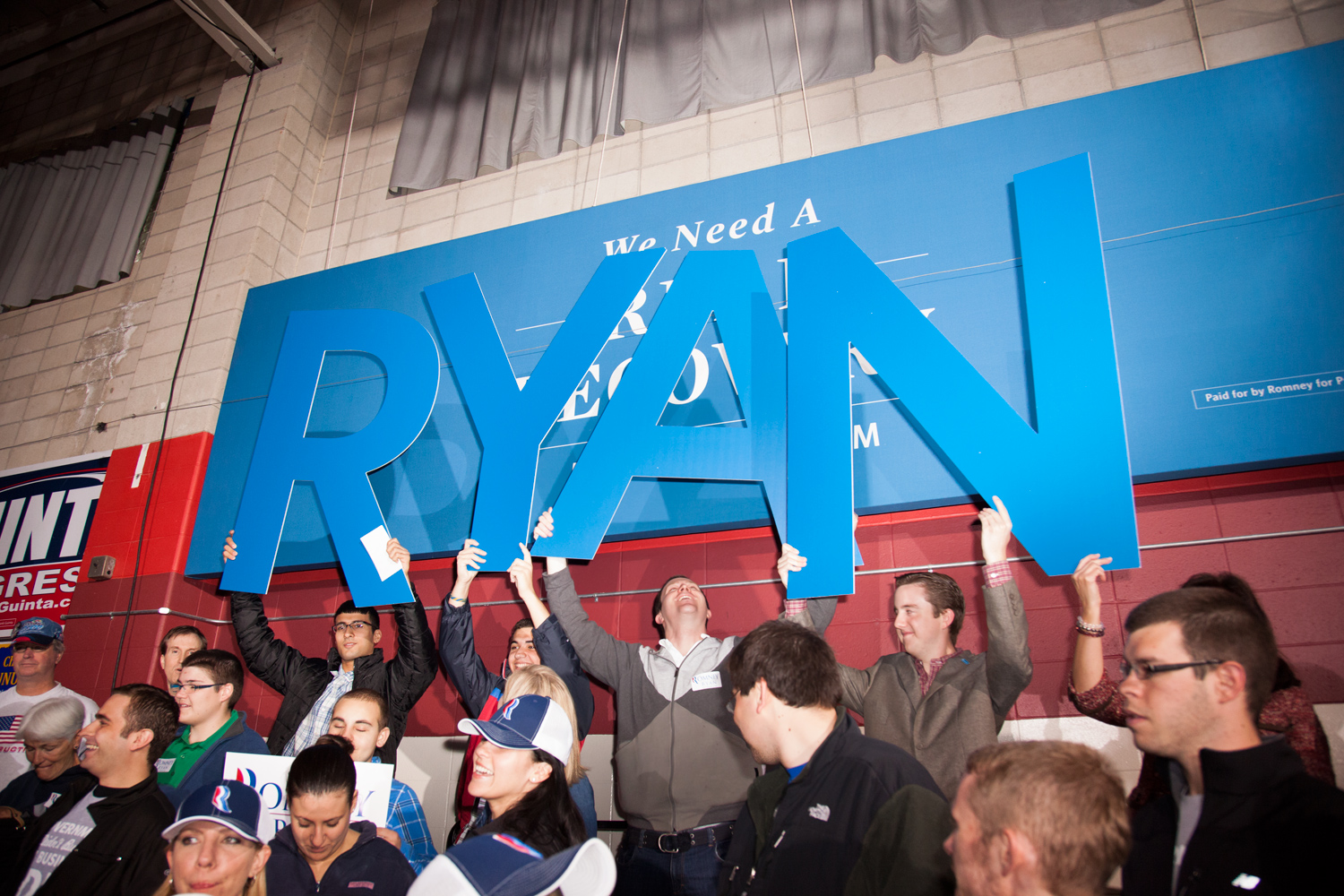Paul Ryan supporters rehearse for Ryan's entry at the  Earn It  Rally in Derry, N.H. Sept. 29, 2012.