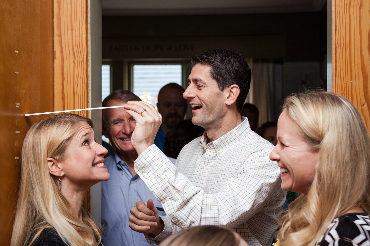 Paul Ryan compares his wife Jana's height to her childhood measurements at her grandmother's former home in Clinton, Iowa. Oct. 2, 2012.