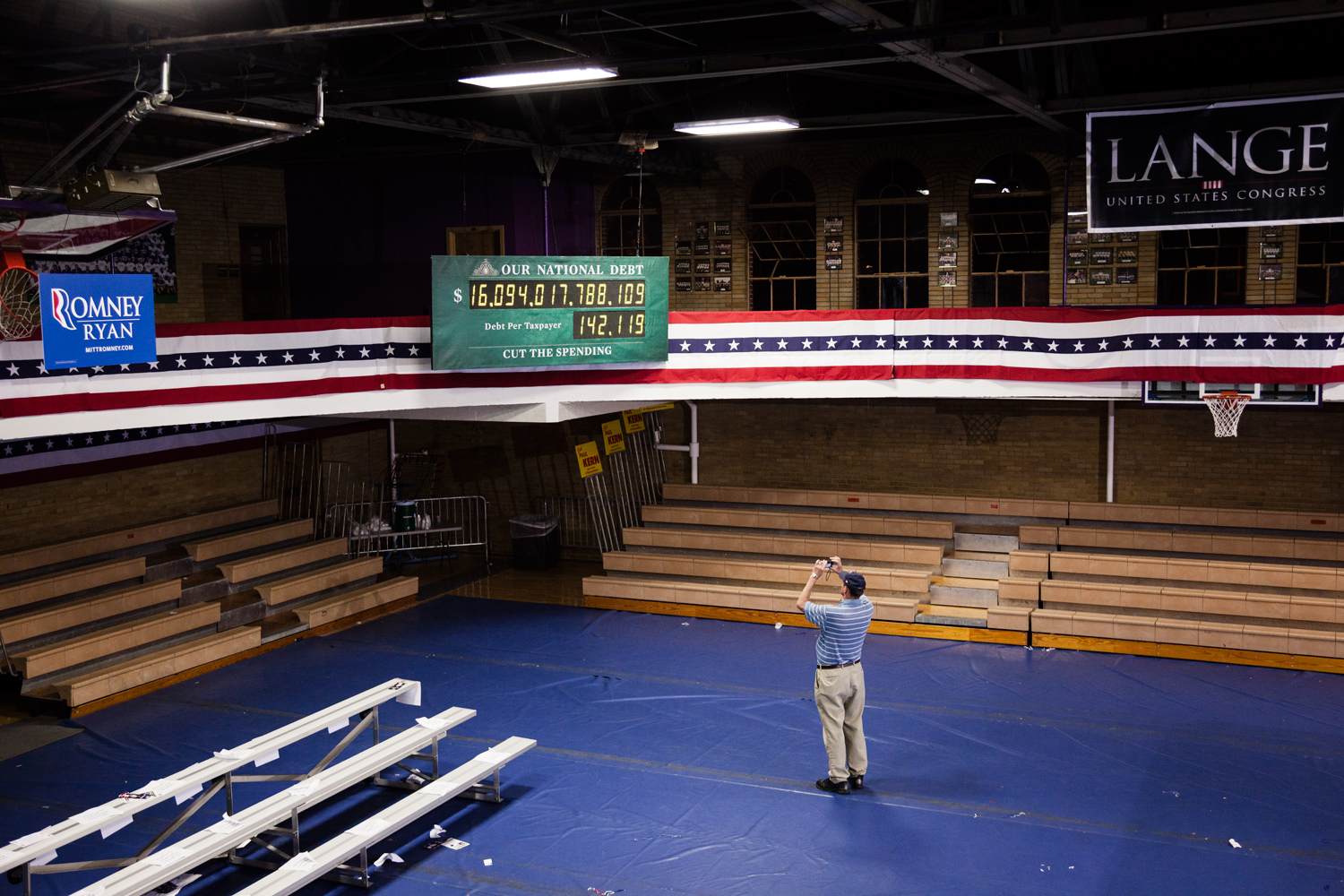 A man photographs the debt clock after the Dubuque Victory Rally and Bus Tour Kickoff in Dubuque, Iowa. Oct. 1, 2012.