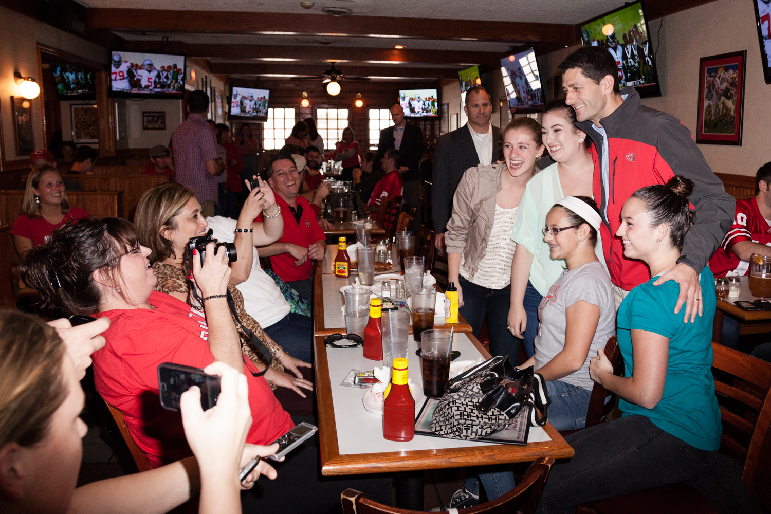 Paul Ryan poses for a picture with Ohio State fans at the Varsity Club, a sports bar in Colombus, Ohio. Sept. 29, 2012.