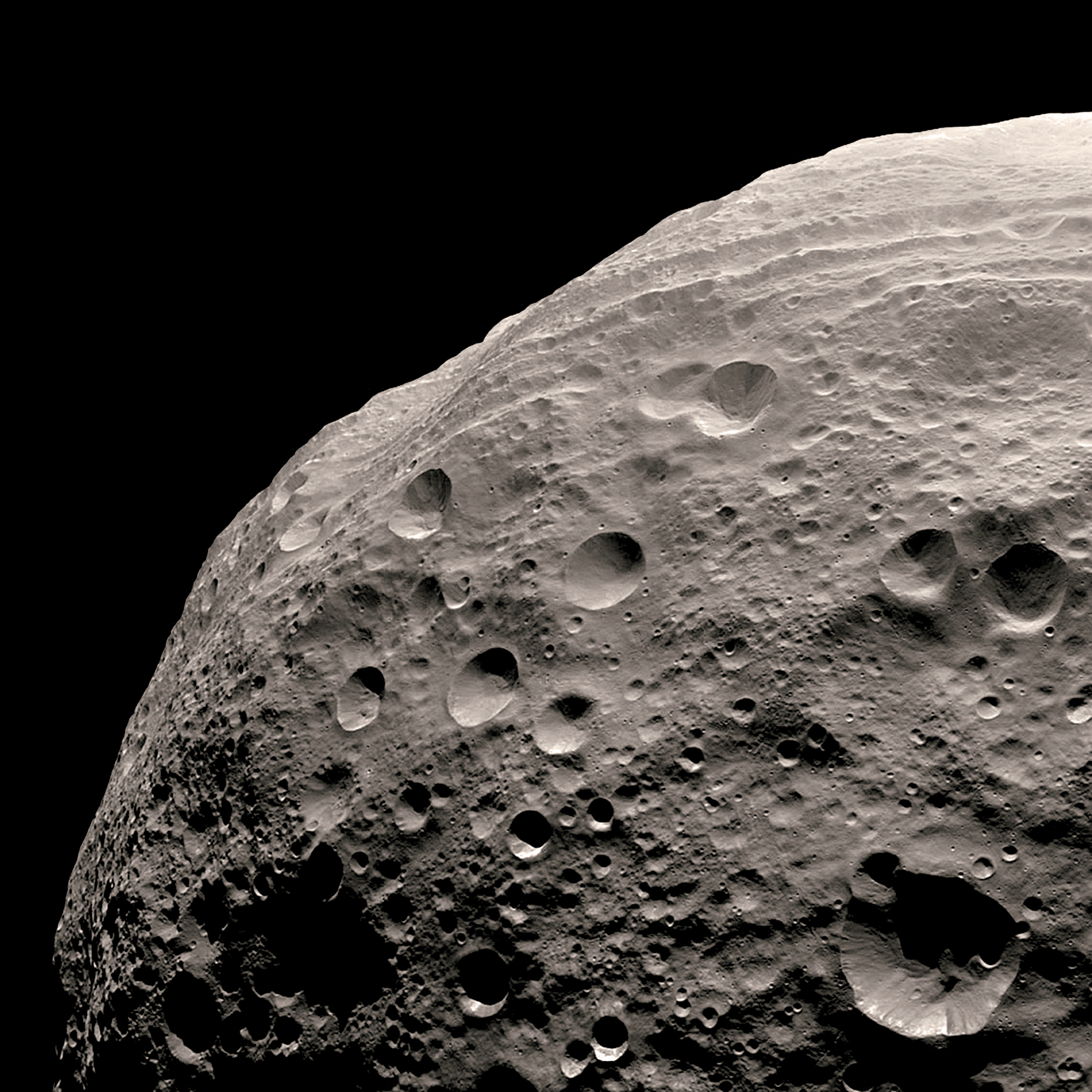 Closer view of asteroid Vesta's cratered surface. Vesta is one of three surviving remnant protoplanets in the asteroid belt—a vast ring between the orbits of Mars and Jupiter.                                Dawn, Aug. 11, 2011