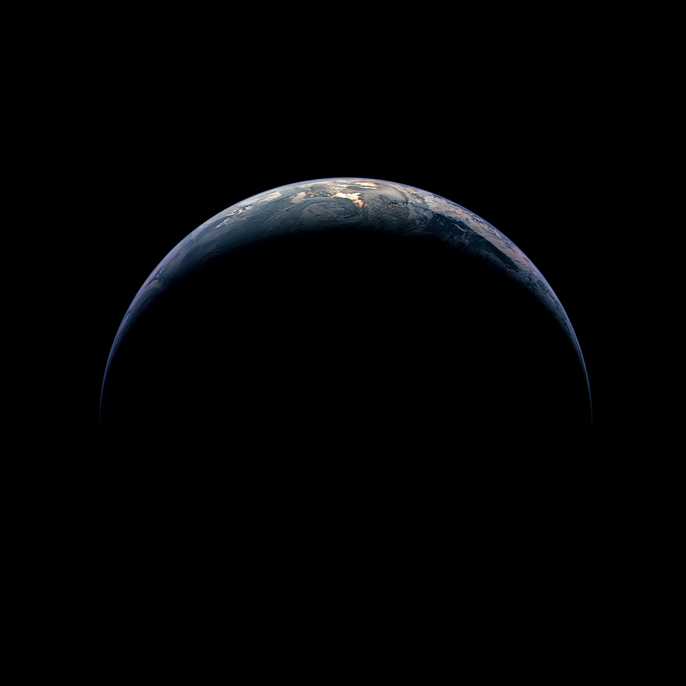 Reflected sunlight glows through clouds over the South Pacific in this view of crescent Earth taken from 217,500 miles away, or almost the distance of the Moon.                                Rosetta, Nov. 13, 2009