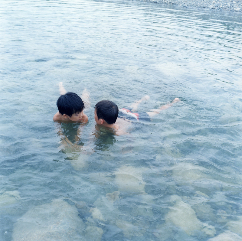 Untitled, 2012                               Rinko Kawauchi responded to Mann's book by photographing her own cousins and nephews.