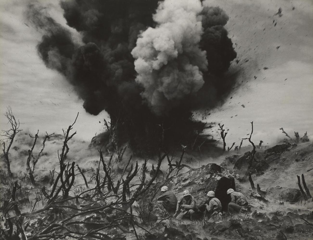 Marine Demolition Team Blasting Out a Cave on Hill 382, Iwo Jima, from the photo-essay Iwo Jima                               1945                               W. Eugene Smith, American, 1918-1978