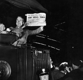 President Harry Truman jubilantly holds up a Chicago newspaper emblazoned with the (erroneous) headline, DEWEY DEFEATS TRUMAN. In fact, Truman handily beat New York governor Thomas Dewey in the tight 1948 presidential election.
