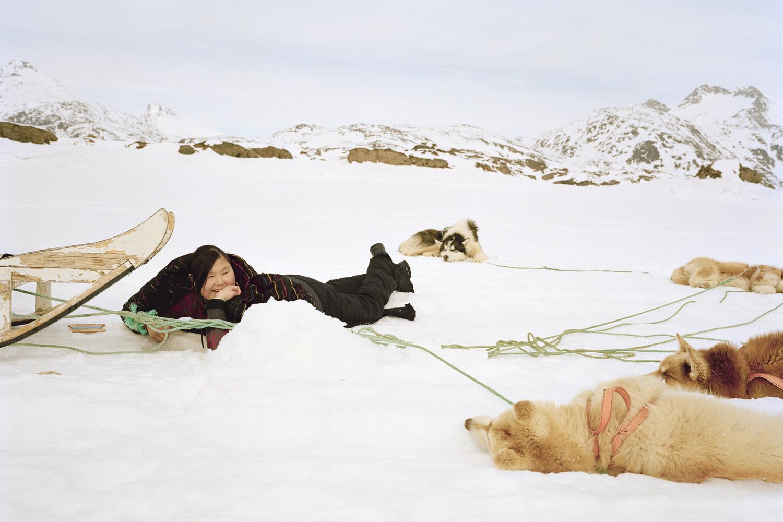 Qaammaqqivaar by Verena Bruening: Ingrid, 16 years old, on a school trip for icefishing, Tasiilaq, 2010.