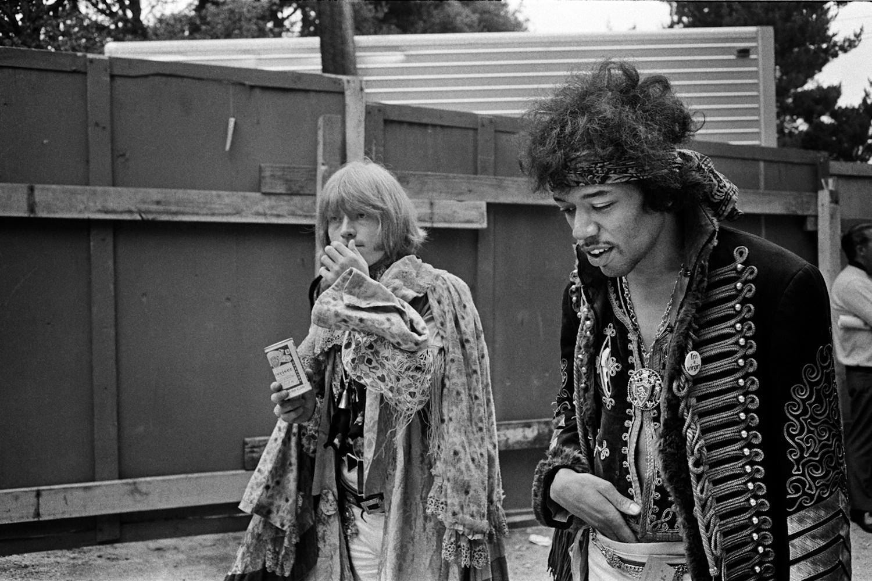 Jimi Hendrix and Brian Jones walk backstage at the Monterey Pop Festival, 1967.