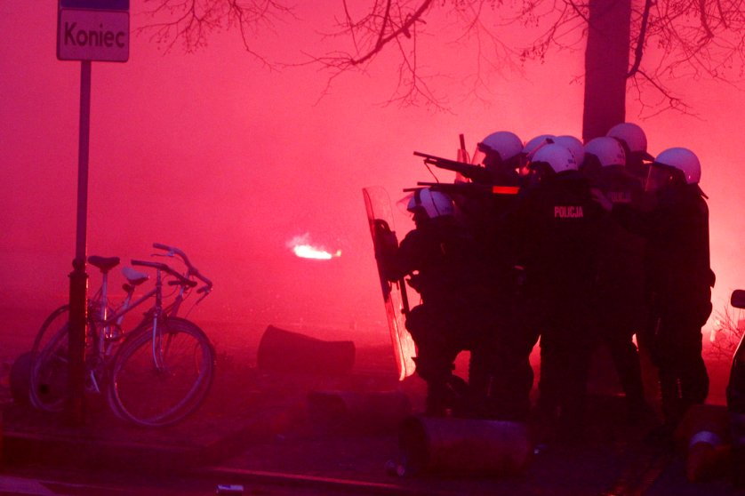 Image: Nov. 11, 2012. Police secure the area during clashes at the March of Independence marking Poland's Independence Day, in Warsaw.