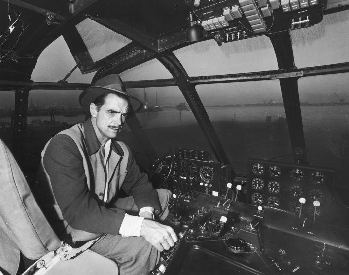 """Howard Hughes' at the controls of his H-4 Hercules troop transport plane, the """"Spruce Goose,"""" November 1947."""