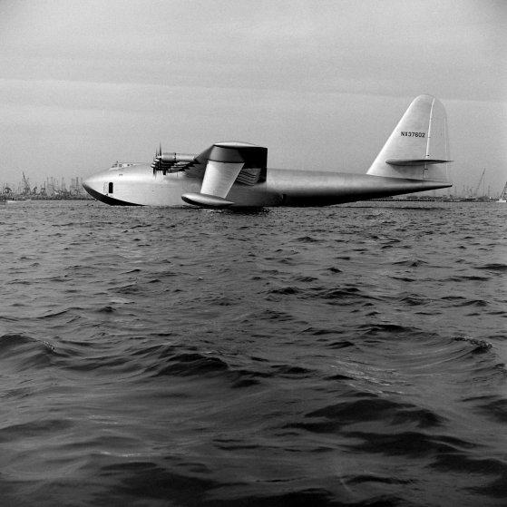 "Howard Hughes' H-4 Hercules troop transport plane, the ""Spruce Goose,"" Long Beach Harbor, Calif., November 1947."