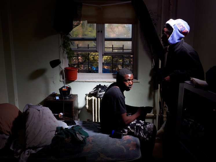 Image: Elijah Jones, 23, sits in his room on the fourth floor of the Redfern Houses.