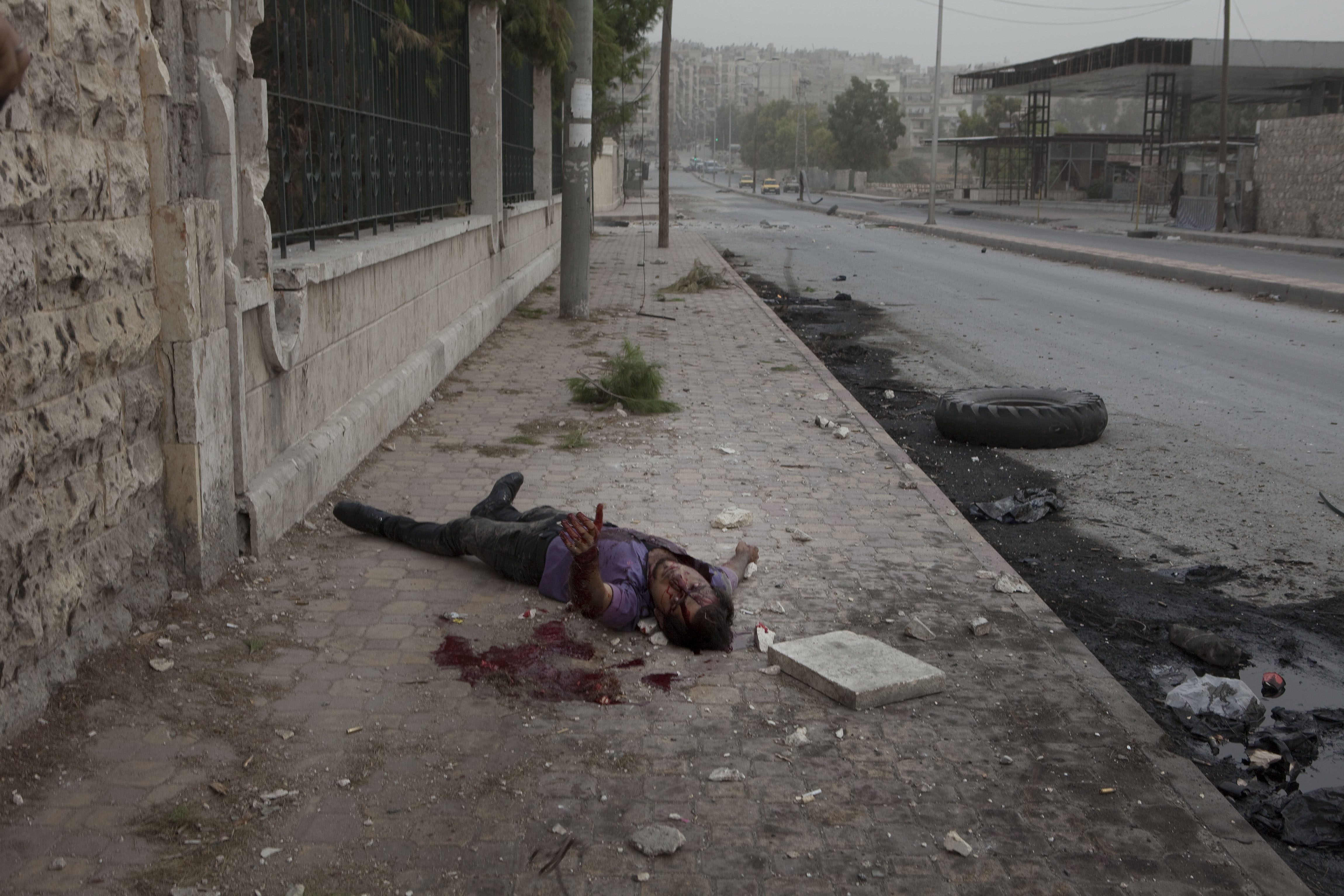 Jerome Sessini                                This 19-year-old civilian boy was shot in the throat by a Syrian sniper as he was crossing the avenue. It brought me roughly into one of the realities of war: that death strikes everyone, people like you and me. I assume that the short distance from the subject gives a partial and fragmented vision of reality, but in this kind of situation, it makes the difference between a good photo and an image that affects consciences.