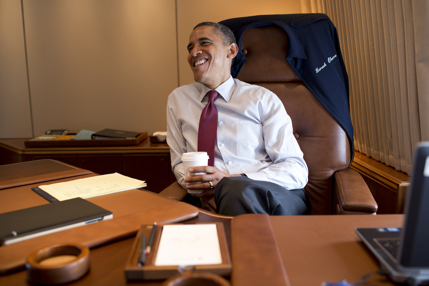 President Obama works in his private office aboard Air Force One.