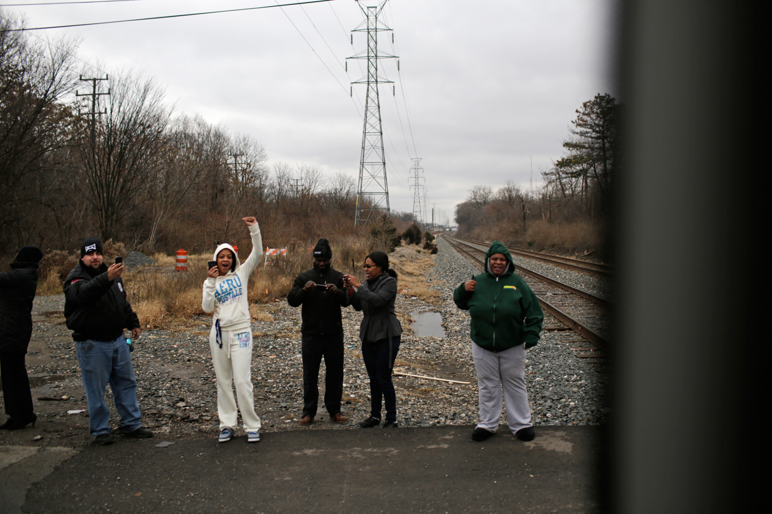 Residents in Redford, Mich., lined the road to catch a glimpse of Obama's motorcade.