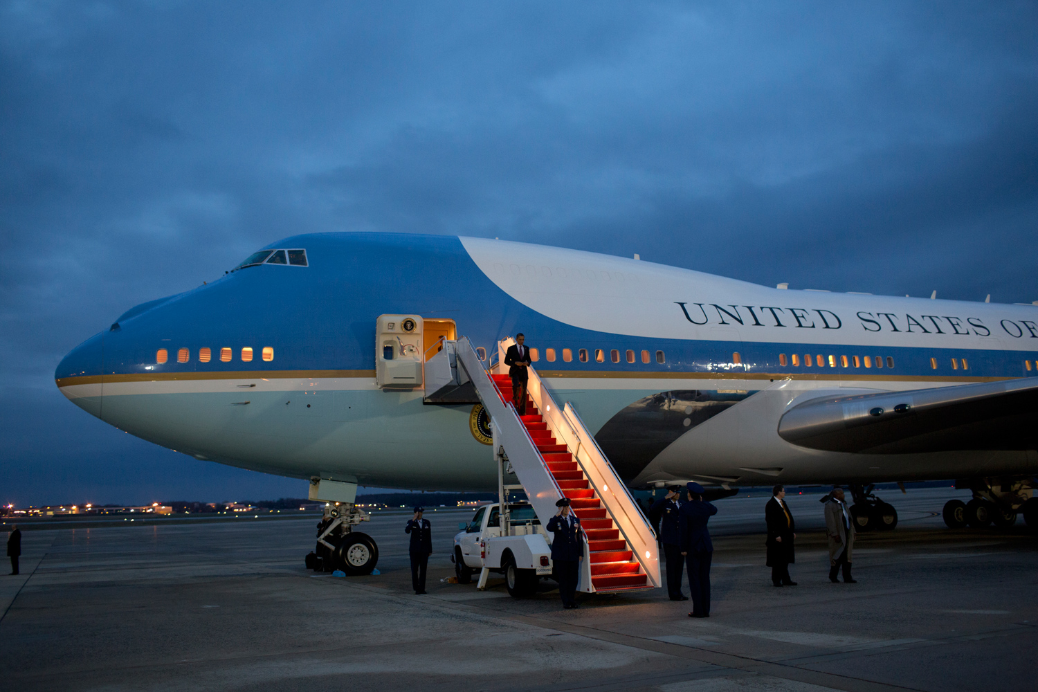As dusk falls, the President arrives back at Andrews Air Force Base in Maryland.