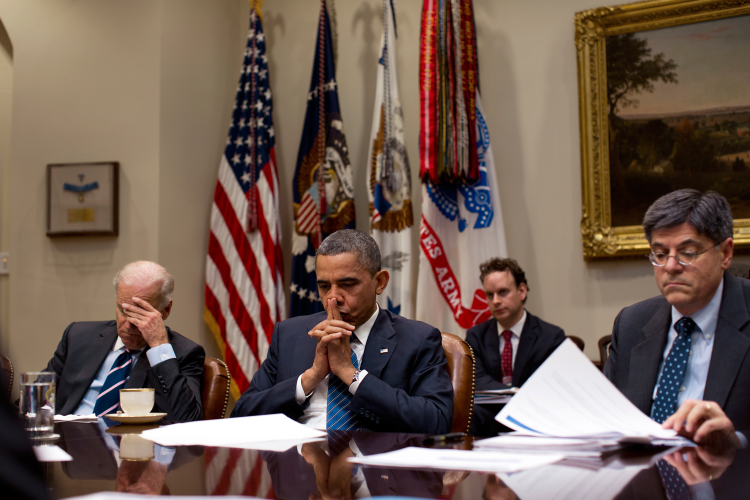 President Obama, Vice President Biden and Chief of Staff Jack Lew listen during a policy meeting in the Roosevelt Room of the White House.