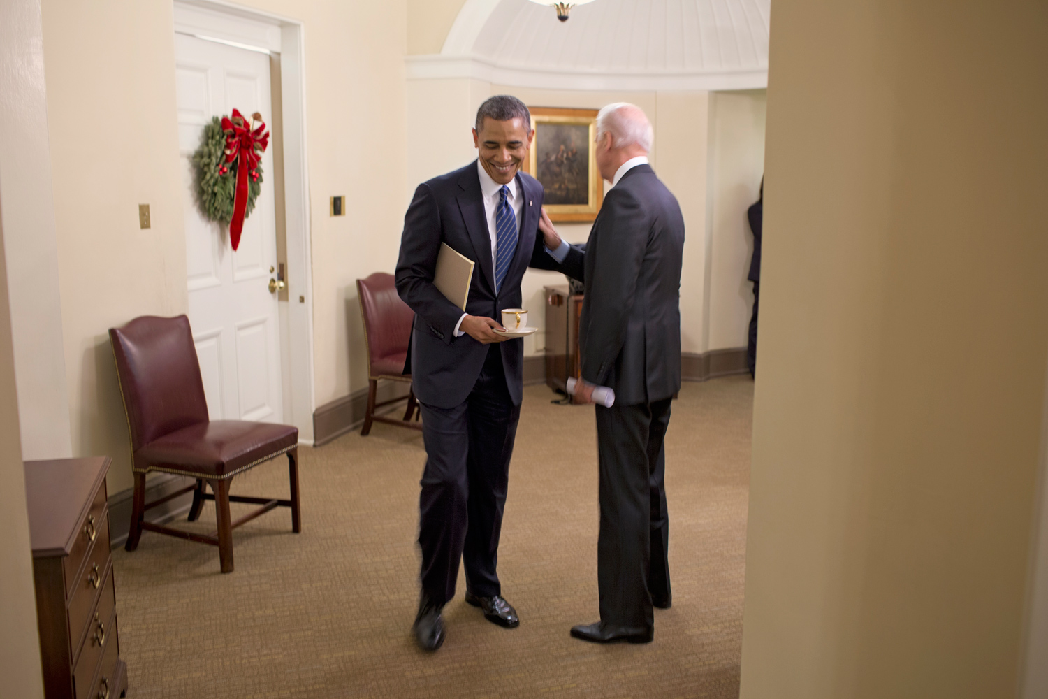 In the hallways outside the Roosevelt Room, Obama and Biden share a brief word following the policy meeting.