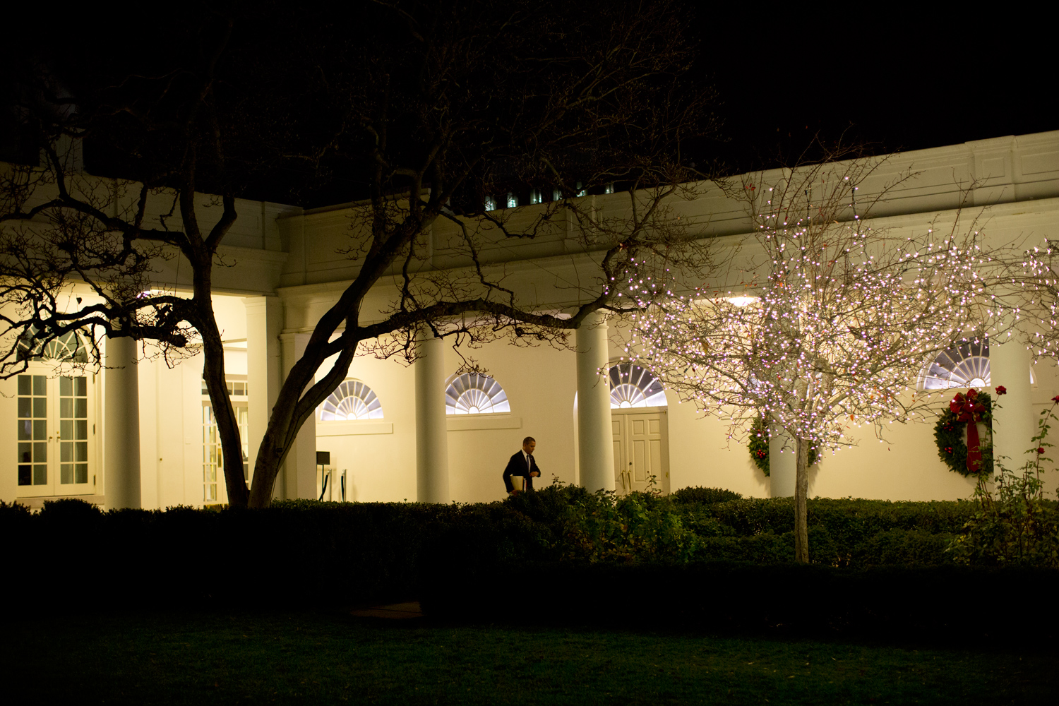 At the end of the day, with many folders and briefings in hand, Obama heads along the Colonnade, adorned with Christmas decorations, to the Residence of the White House.