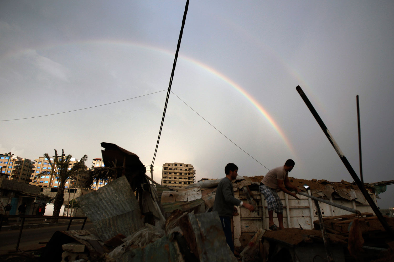 Peace in the Middle East                               Nov. 23, 2012. Palestinians inspect the rubble of a destroyed house as a rainbow arcs over Gaza City.