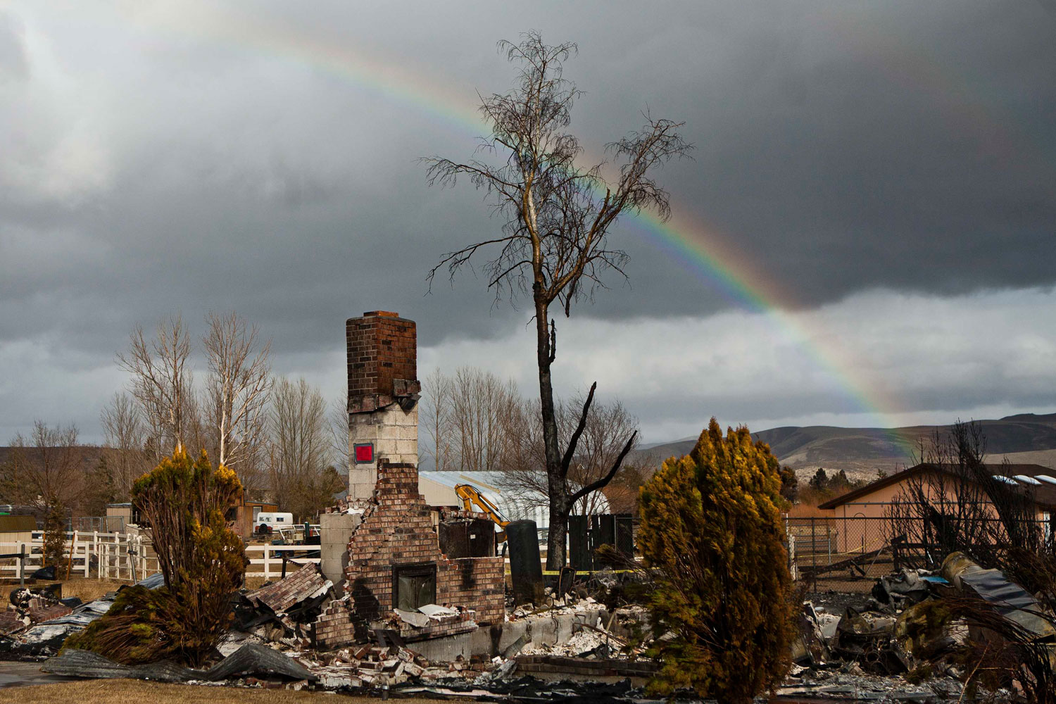 Strategies for Climate Change                               A rainbow is pictured over the remains of a burned home south of Reno, Nevada, January 20, 2012. A fierce brush fire on the outskirts of northern Nevada's largest city left 26 houses in ruins.