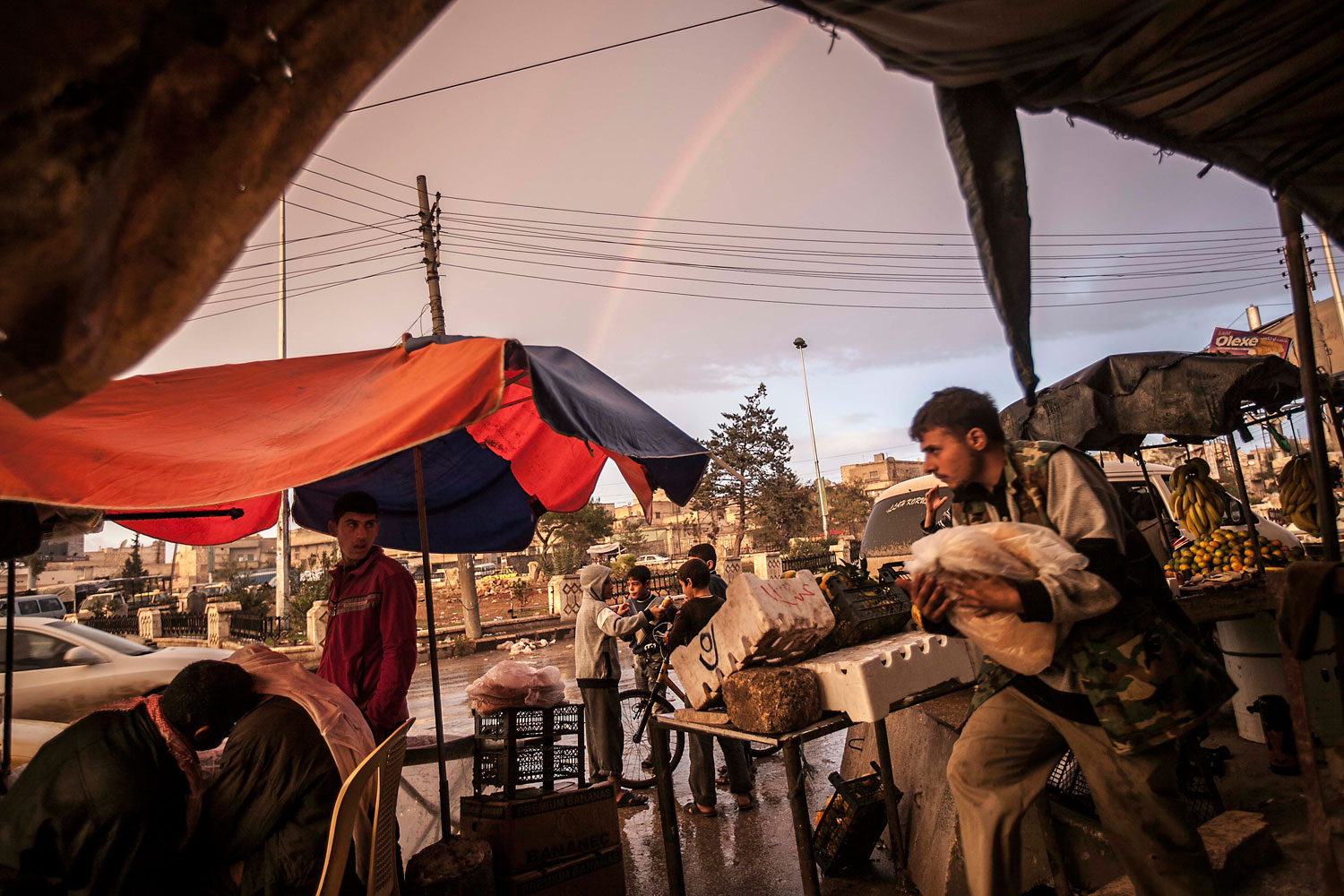 An End to the Syrian Civil War                                                              Nov. 12, 2012. A rainbow appears above a market in the rebel-controlled area of Aleppo, Syria.
