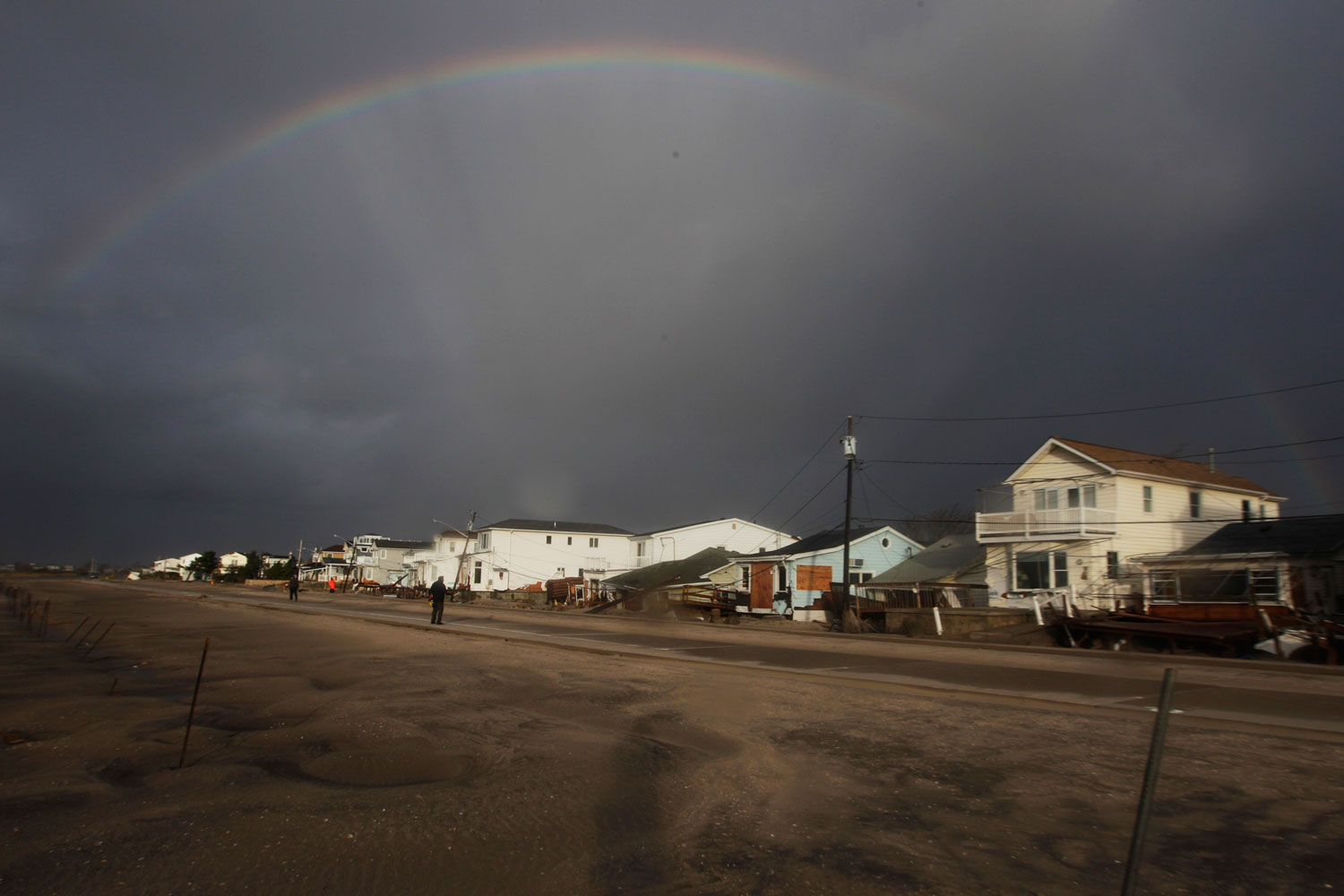 Hurricane Sandy Recovery                               Oct. 30, 2012. A rainbow forms over Breezy Point, Queens, in the aftermath of superstorm Sandy in New York. Fire destroyed scores houses in the flooded neighborhood.