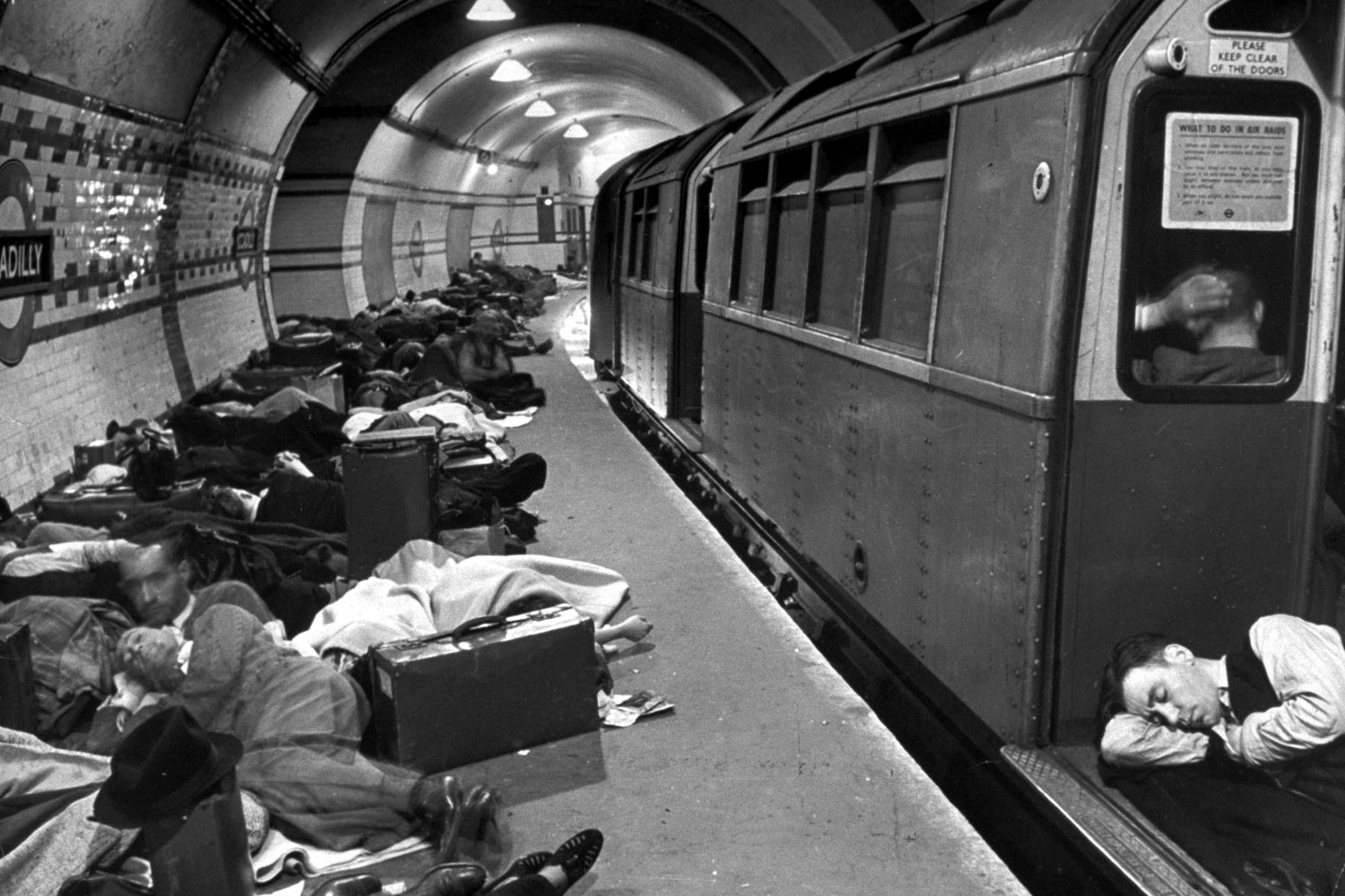 Londoners sleep in the city's Underground for protection during German bombing raids, 1940.