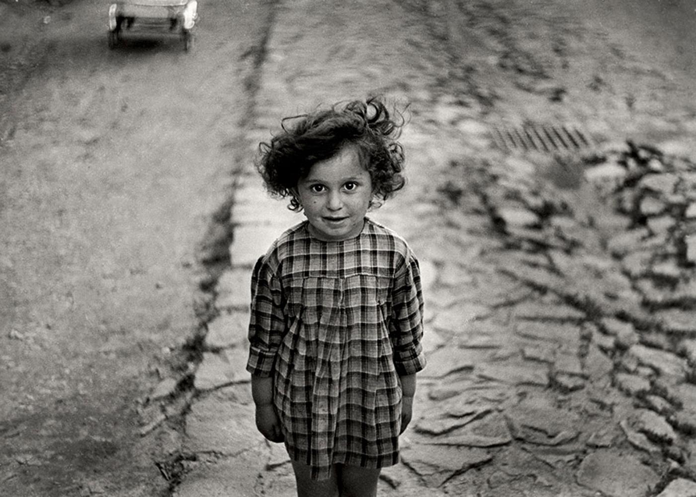 Girl in plaid dress, Mukacevo, Ukraine ca. 1935–38.