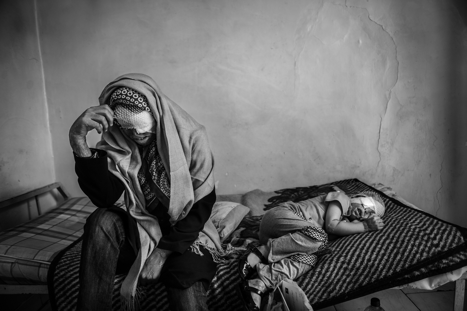 The following photographs were taken between May and December of 2012.Sommayeh and her daughter Rana rest in a hostel in downtown Tehran. The two have shuttled to the Iranian capital for treatment after Sommayeh's husband attacked the family with acid.