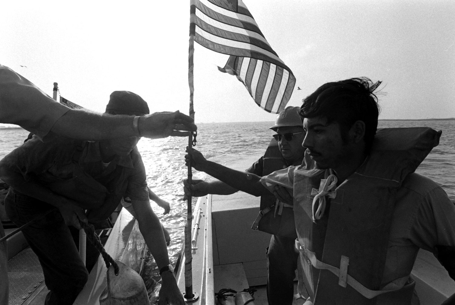 Customs agents with suspected drug smugglers, Falcon Lake, Texas, 1969.