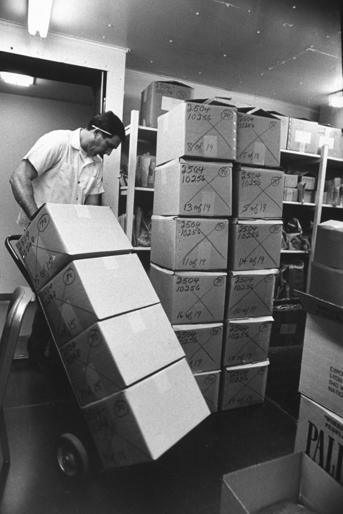"""<b>Caption from LIFE.</b> A 500-pound cache of confiscated marijuana is removed from warehouse-like storage vault in San Diego, then burned in raging furnace, one brick at a time."""" (See last image in gallery.)"""