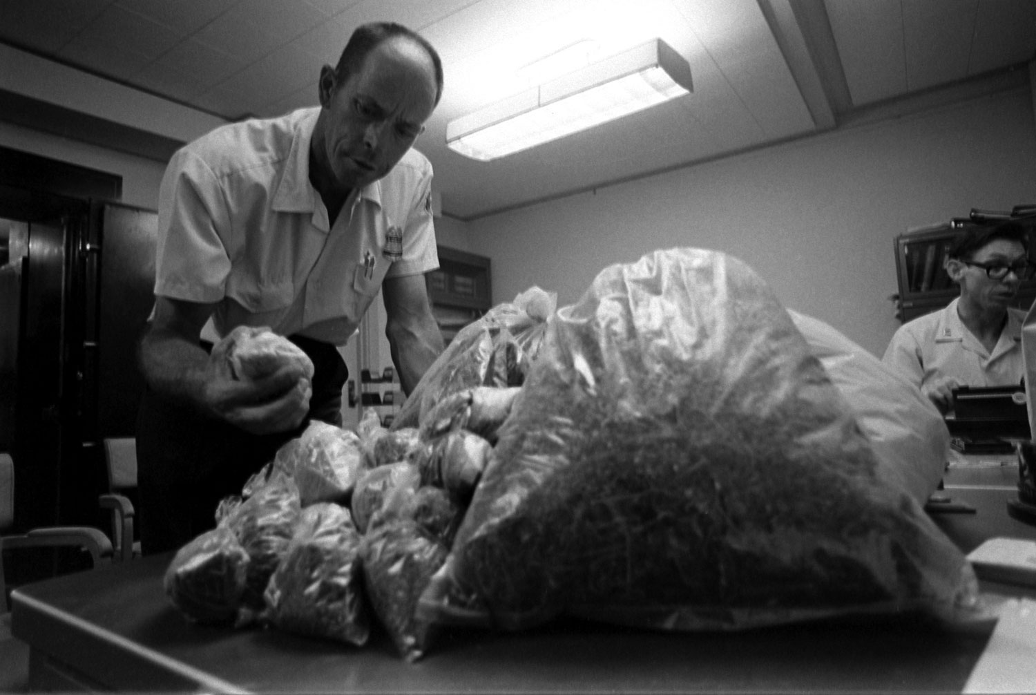 U.S. Customs agents with seized marijuana.