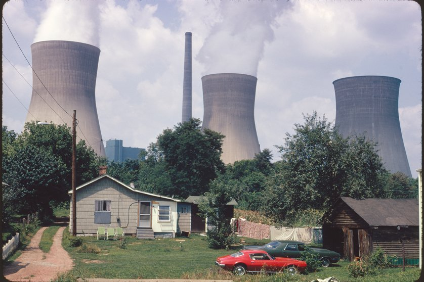 Water cooling towers of the John Amos Power Plant loom over Poca, WV, 1973.