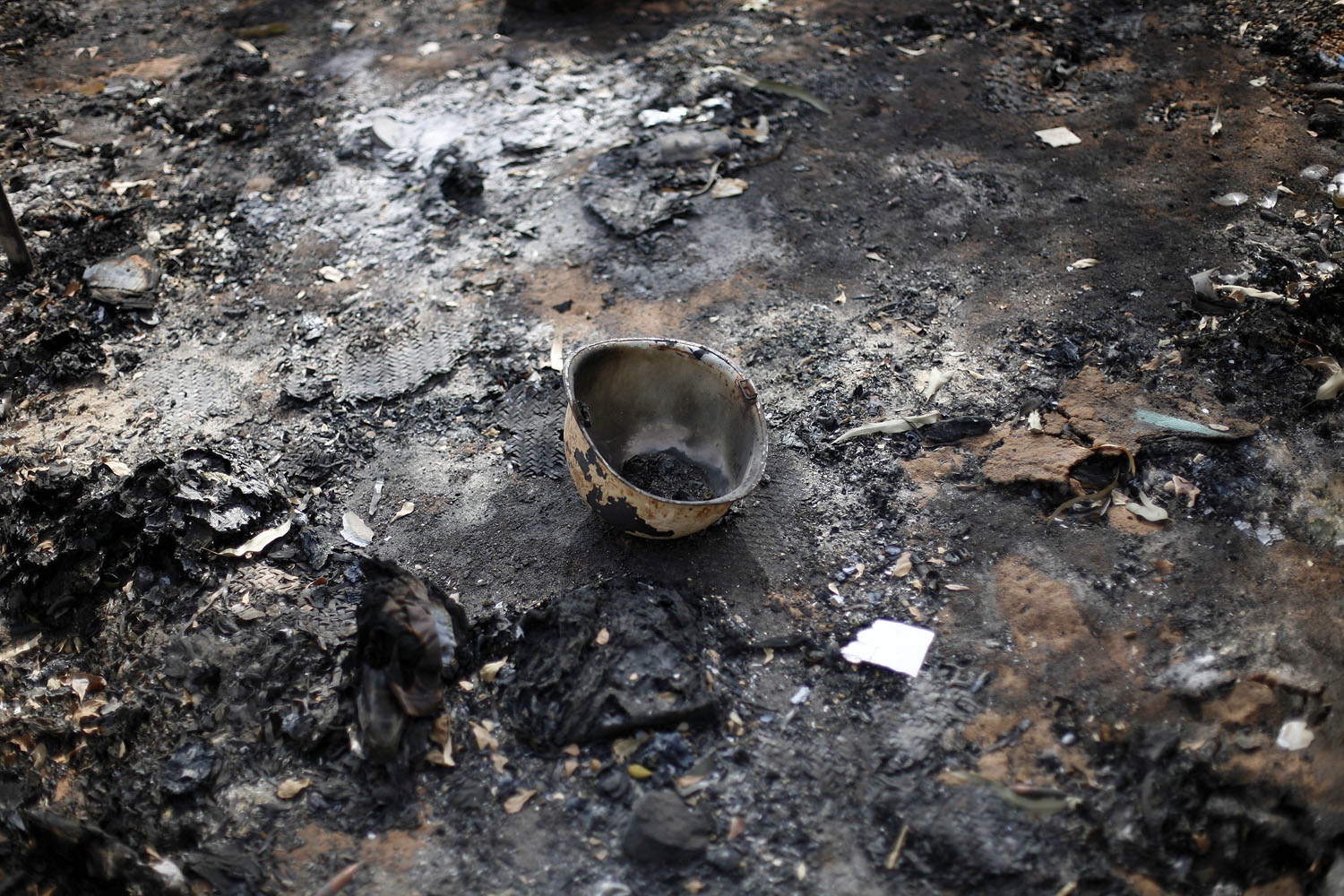 A charred helmet lays on the ground of a destroyed base used by Islamist rebels, Jan. 26, 2013.