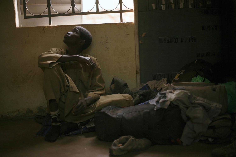 Adama Drabo, 16, sits in the police station in Sevare, some 620 kilometers (385 miles) north of Mali's capital, Jan. 25, 2013.