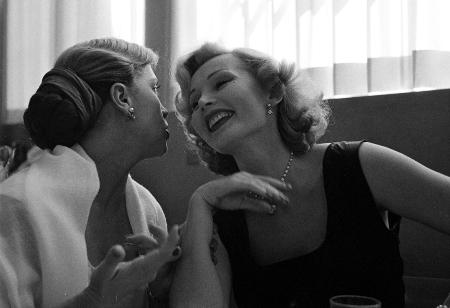 Zsa Zsa Gabor at lunch with French actress Denise Darcel, California, 1951.