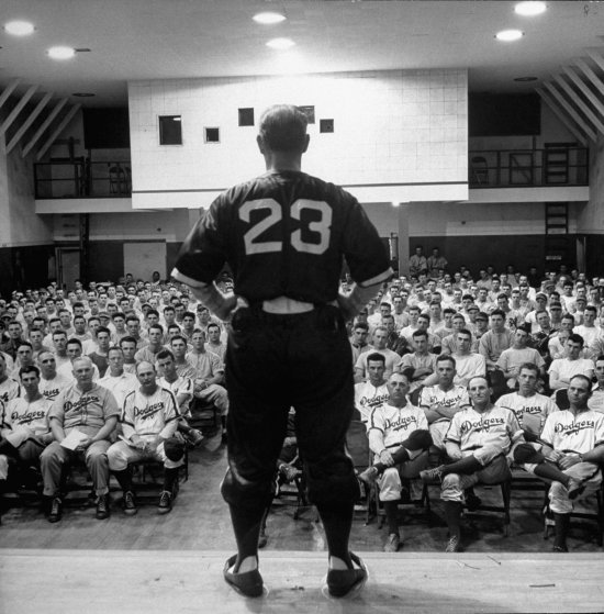 Fresco Thompson, a former National League infielder, talks to Dodger coaches and prospects, Dodgertown, Fla., 1948.