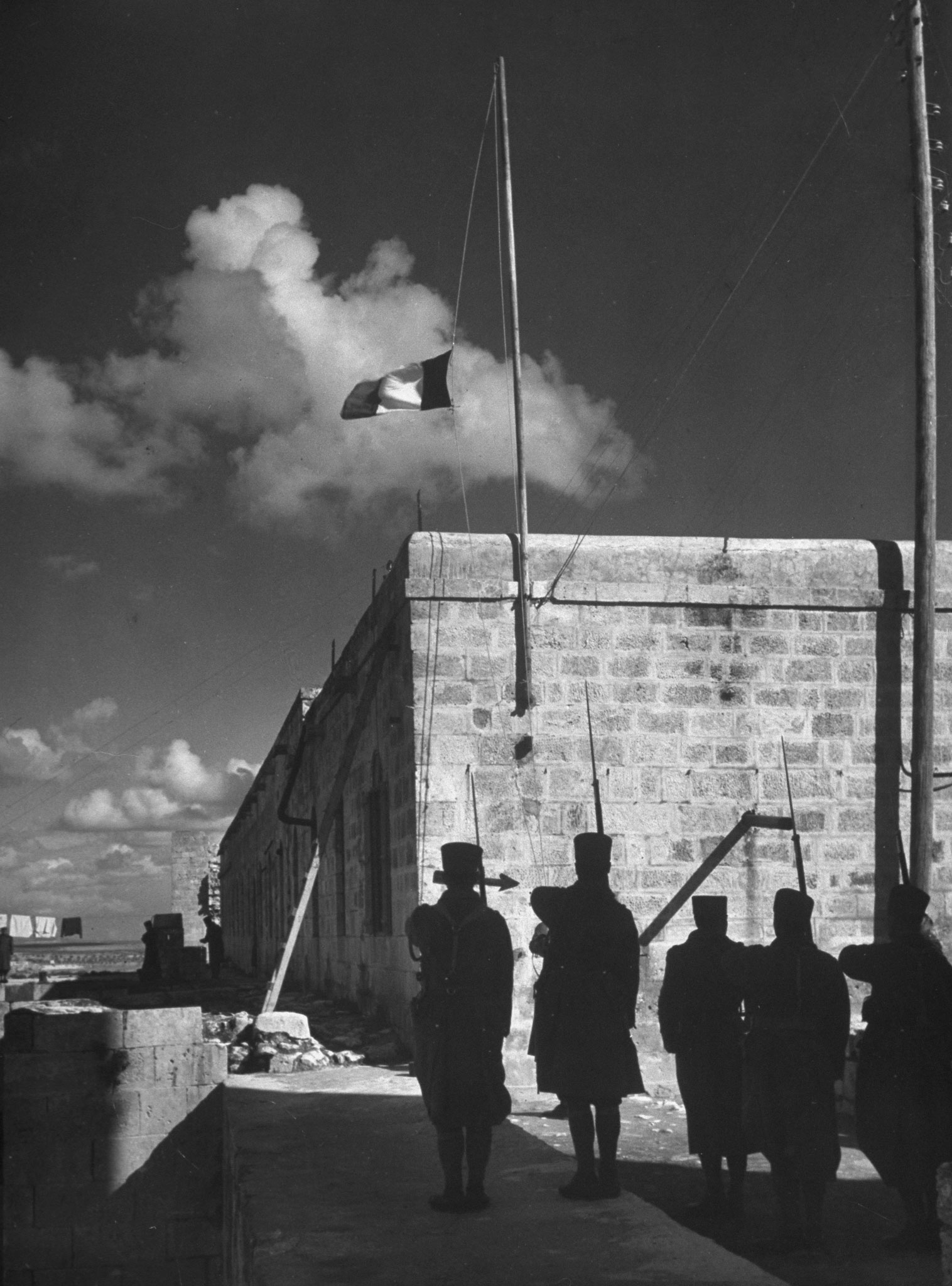 Raising the French flag at Aleppo, Syria, 1940.