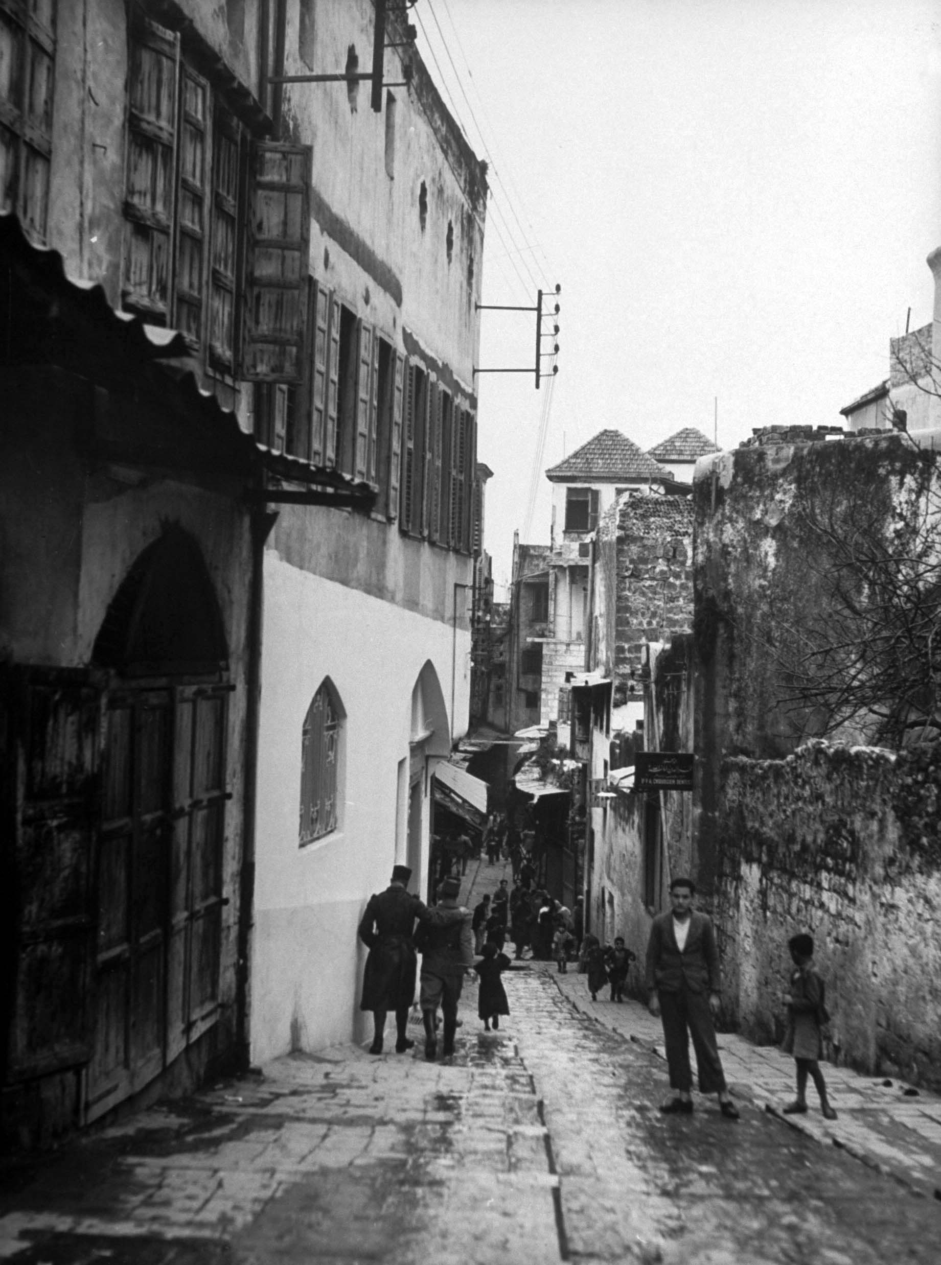 A narrow street in downtown Aleppo, Syria, 1940.