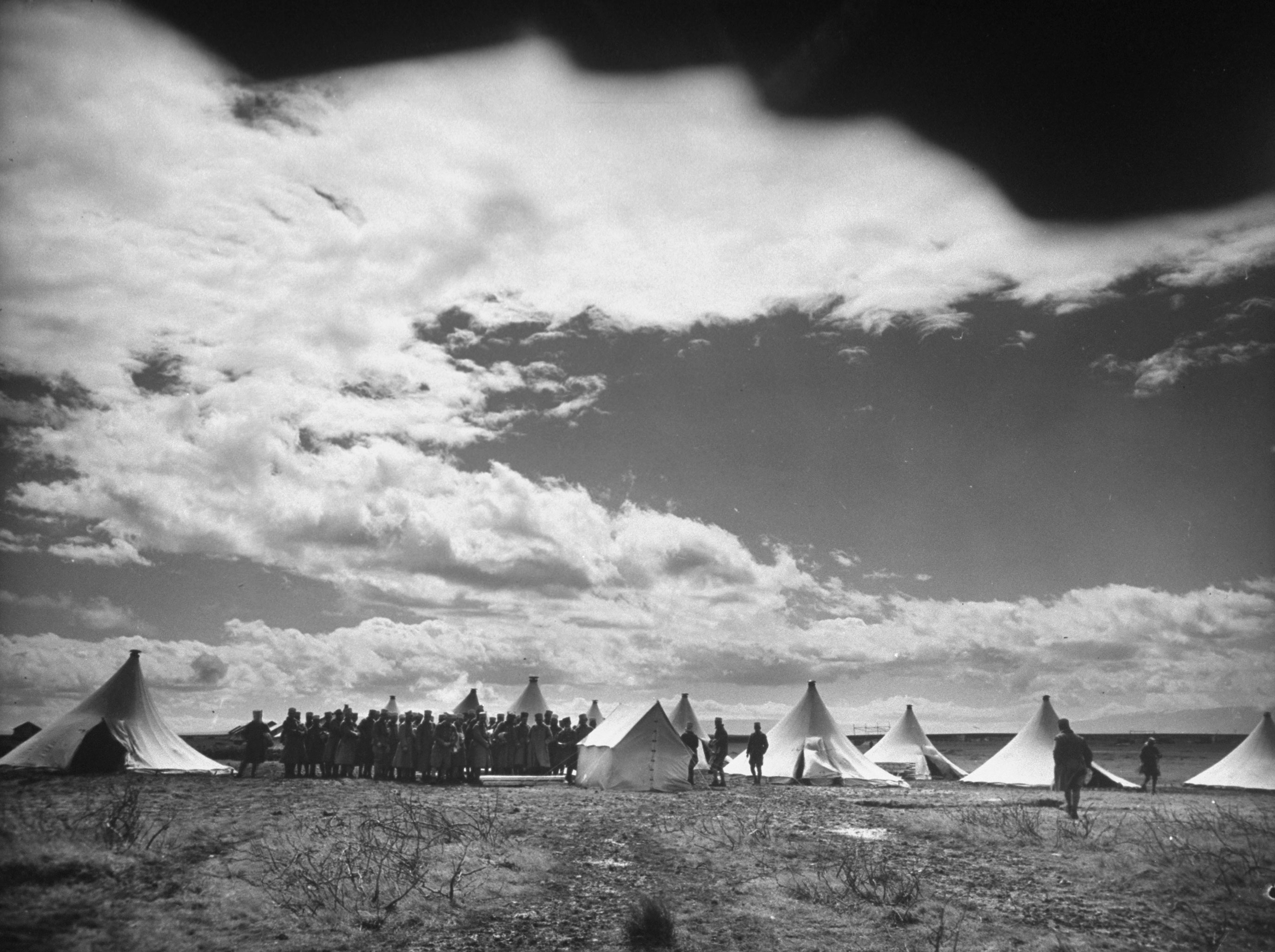French Foreign Legion soldiers gather around newly erected tents as they set up their outpost near Homs, Syria, 1940.