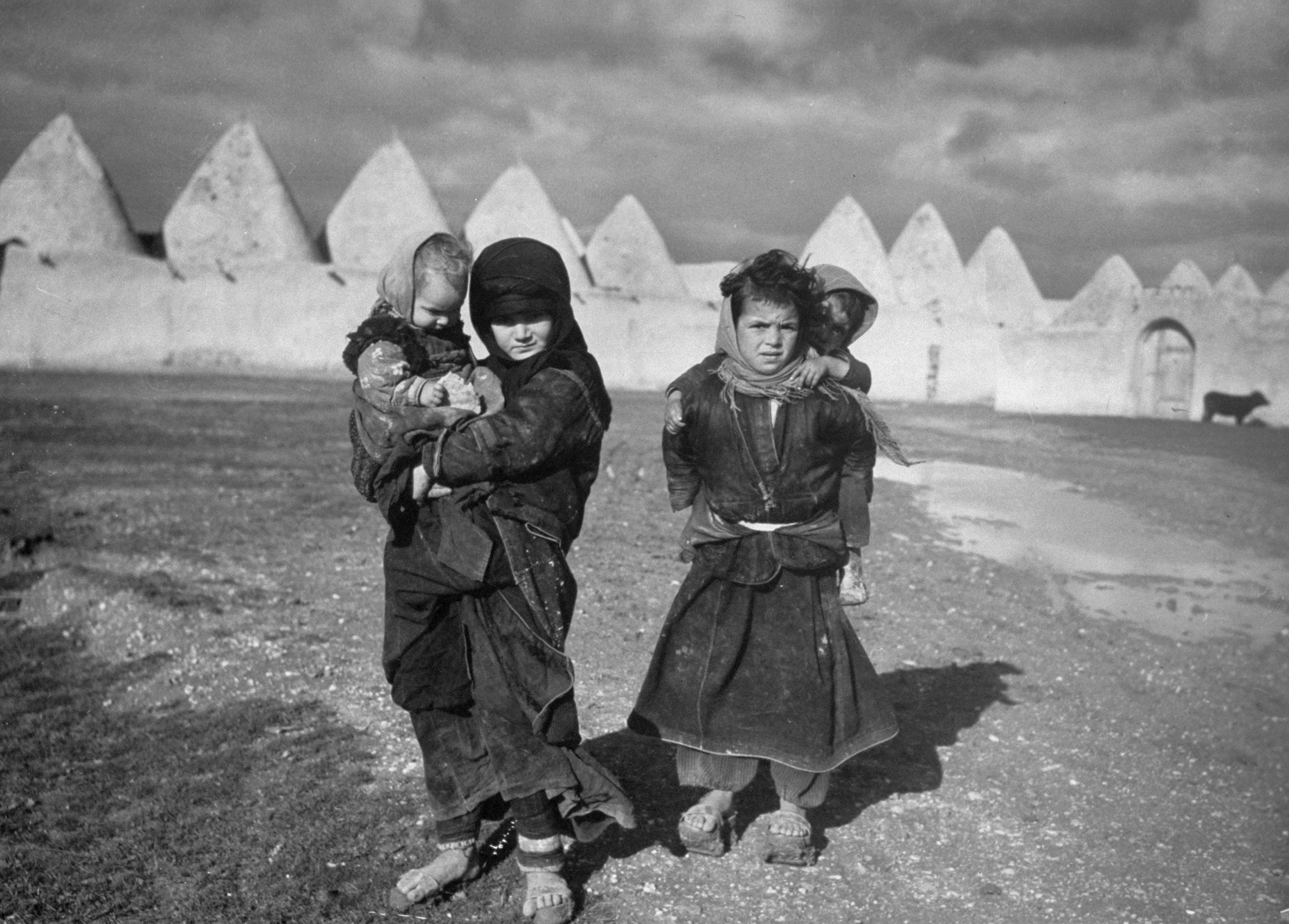 Syrian children outside the walled town of Tell Bisse, Syria, 1940.