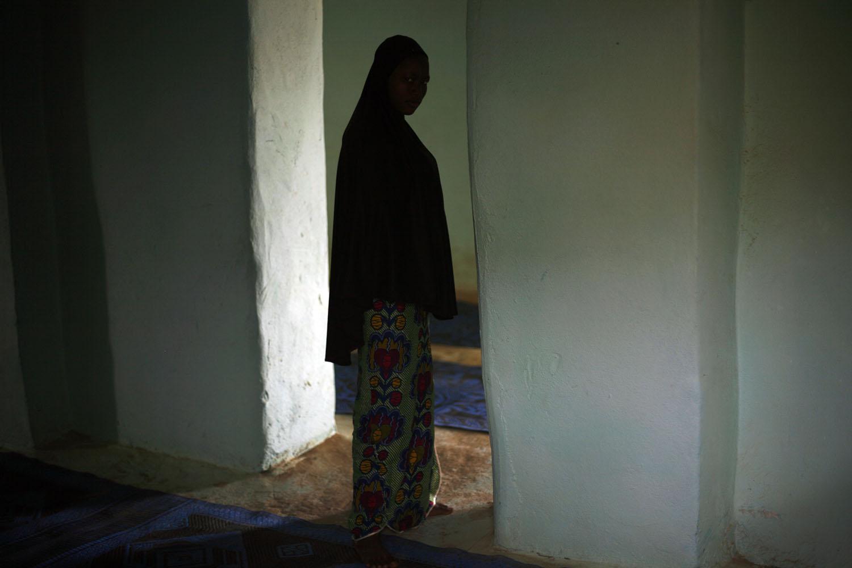 A Young Malian girl walks through the school in Gao, Feb. 13, 2013.